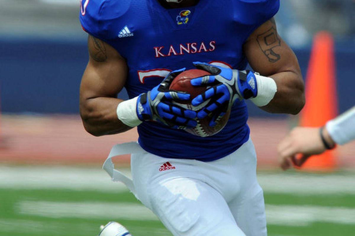 Apr 28, 2012; Lawrence, KS, USA; Kansas Jayhawks wide receiver D.J. Breshears (10) rushes for yardage in the first half of the Spring Game at Memorial Stadium. Mandatory Credit: John Rieger-US PRESSWIRE