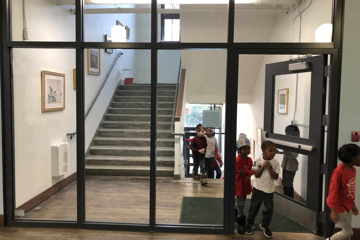 Students walk through the hallways at Detroit Prep, a charter school that is among more than 800 K-12 schools in the state that must close to slow the spread the coronavirus.