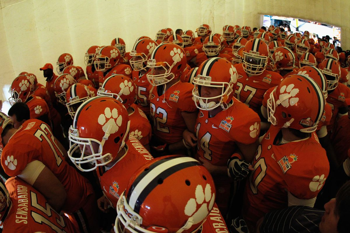 The Clemson Tigers gather in the tunnel prior to taking the field to play against the West Virginia Mountaineers during the Discover Orange Bowl at Sun Life Stadium on January 4, 2012 in Miami Gardens, Florida.  (Photo by Streeter Lecka/Getty Images)