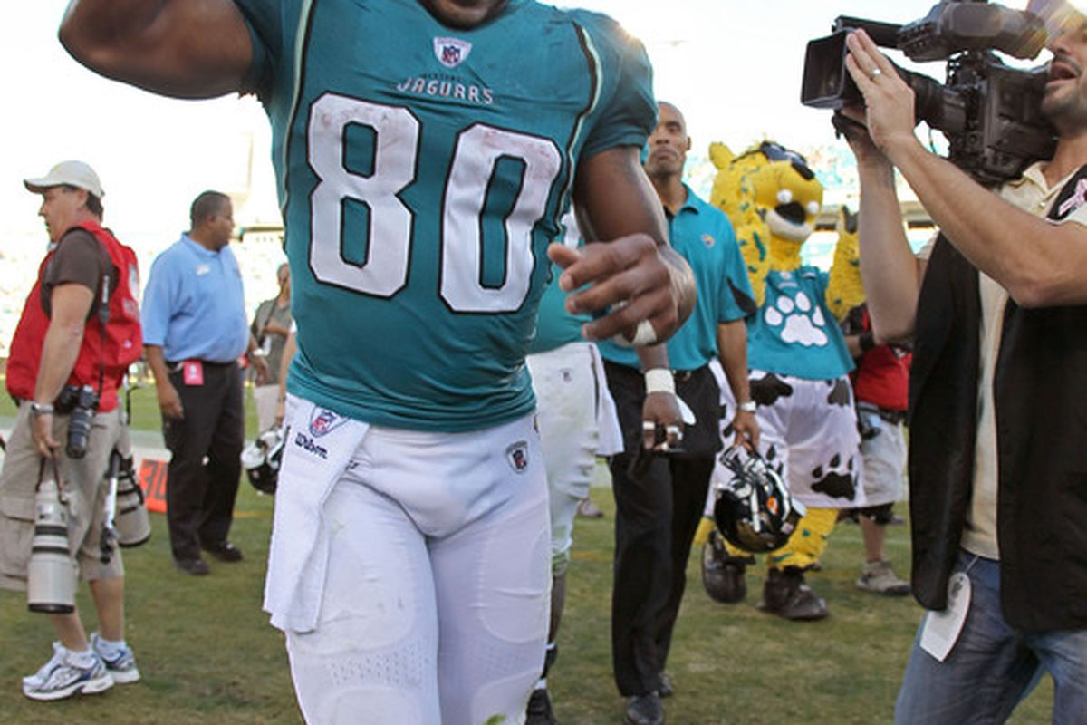 Mike Thomas celebrates the extra day off he was just given by Coach Del Rio.