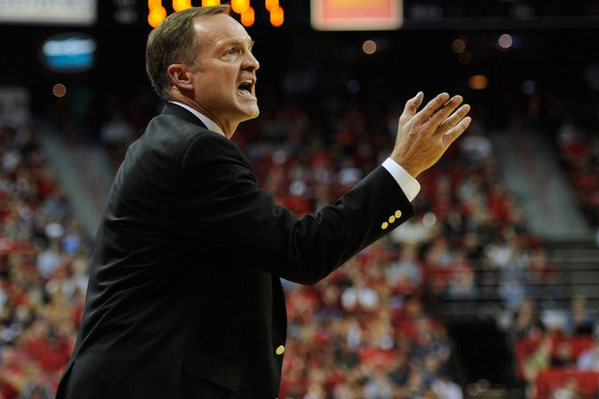 LAS VEGAS NV - FEBRUARY 12:  Head coach Lon Kruger of the UNLV Rebels gestures to his players during a game against the San Diego State Aztecs at the Thomas & Mack Center on February 12 2011 in Las Vegas Nevada.  (Photo by Ethan Miller/Getty Images)
