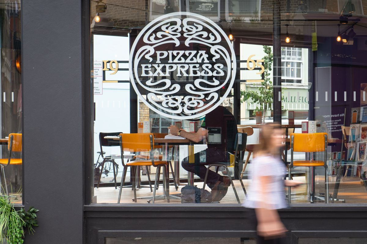Pizza Express restaurant windows in London, with the brand logo prominently visible