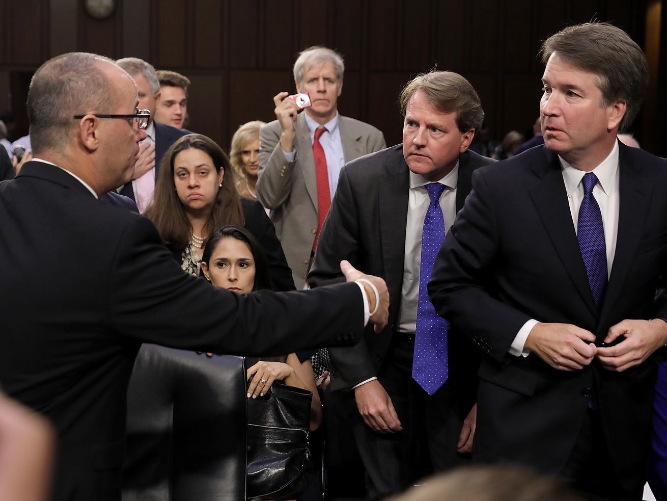 Fred Guttenberg (L), father of Parkland high school shooting victim Jamie Guttenberg, tries to shake the hand of Supreme Court nominee Judge Brett Kavanaugh as Kavanaugh appeared before the Senate Judiciary Committee during his Supreme Court confirmation hearing on Capitol Hill September 4, 2018 in Washington, DC.
