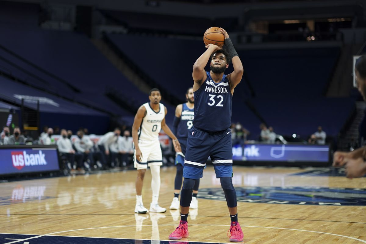 Karl-Anthony Towns of the Minnesota Timberwolves shoots a free throw during the game against the Memphis Grizzlies on January 13, 2021 at Target Center in Minneapolis, Minnesota.
