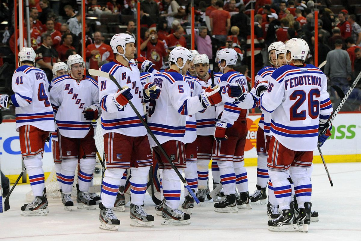 April 16, 2012; Ottawa, ON, Canada; The New York Rangers celebrate the 1-0 victory over the Ottawa Senators in game three of the 2012 Eastern Conference quarterfinals at ScotiaBank Place.  Mandatory Credit: Eric Bolte-US PRESSWIRE