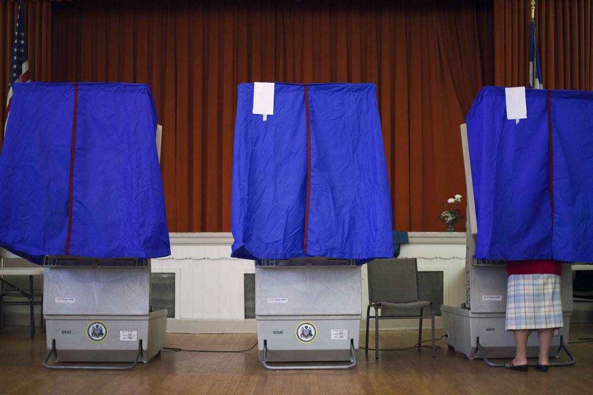 Three voting booths in Philadelphia.