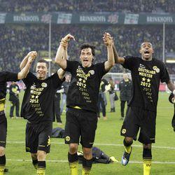 Dortmund players  celebrate winning the 2nd consecutive Bundesliga title after the German first division Bundesliga soccer match between Borussia Dortmund and Borussia Moenchengladbach in Dortmund, Germany, Saturday, April 21, 2012.