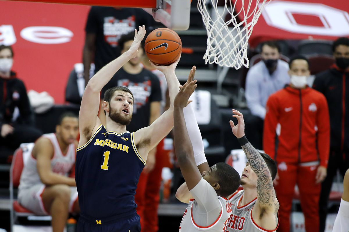 Michigan Wolverines center Hunter Dickinson defended by Ohio State Buckeyes forward E.J. Liddell during the first half at Value City Arena.
