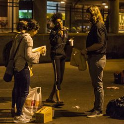 """Activists and faith leaders give doughnuts and coffee to the homeless as they begin to pack their belongings in lieu of the deadline that residents of """"The Triangle"""" were given to evacuate the area by the city of Chicago, Monday, June 11, 2018, in Chicago. 
