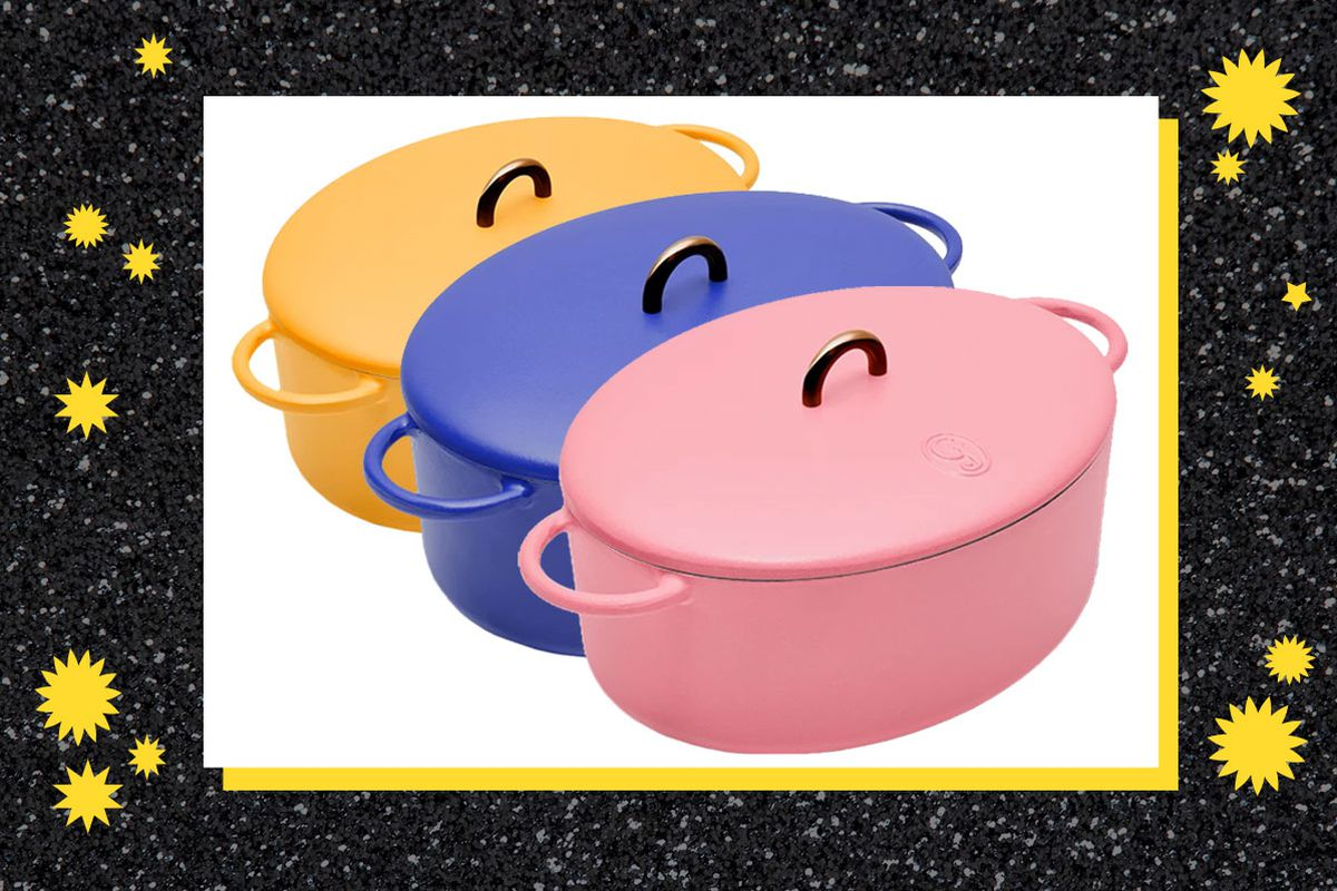 Three Great Jones dutch ovens, one in mustard, one in blue, and one in pink