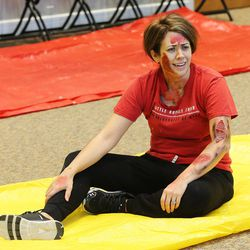 Mallory Woodbury, posing as a disaster victim, waits for first aid from members of the Capitol Hill Community Emergency Response Team during a drill at the State Office Building in Salt Lake City on Wednesday, Nov. 30, 2016. The response team, organized by the Utah Division of Emergency Management, will provide lifesaving support in an emergency to the roughly 1,000 state government employees who work on Utah's Capitol Hill.