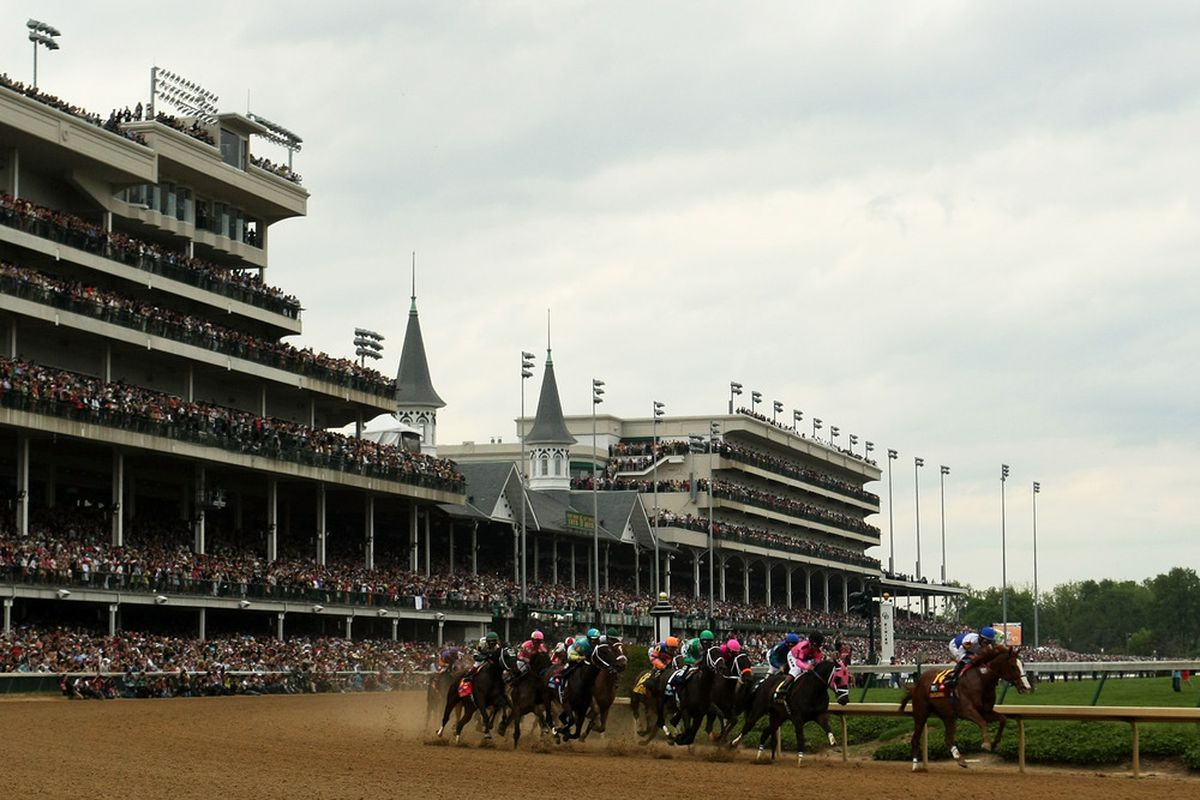 The field rounds turn one during the 137th Kentucky Derby at Churchill Downs on May 7, 2011 in Louisville, Kentucky.  This Saturday marks the 138th running. (Photo by Al Bello/Getty Images)