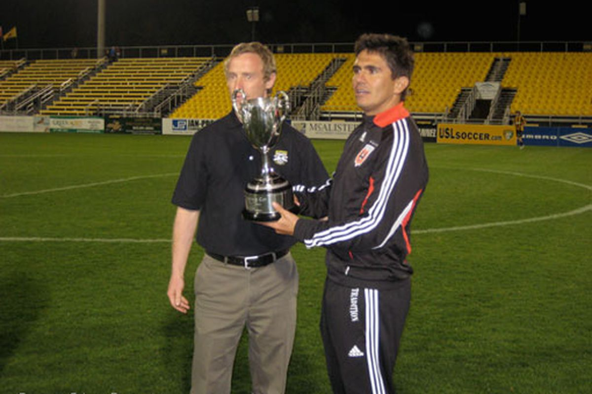 """Jaime Moreno accepts United's first Coffee Pot Trophy, via <a href=""""http://www.behindthebadge.com/032010_Moreno.jpg"""">behindthebadge.com</a>"""