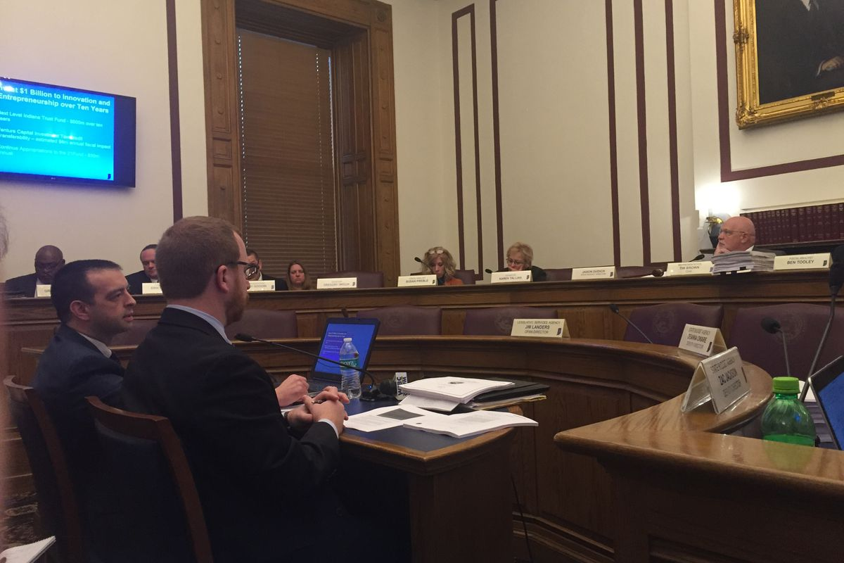 Micah Vincent, the director of the Office of Management and Budget, presents Gov. Eric Holcomb's budget plan to the State Budget Committee.