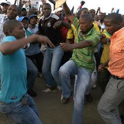 Miners sing and dance after accepting a pay rise in Lonmin Platinum Mine near Rustenburg, South Africa, Tuesday, Sept. 18, 2012. Striking miners have accepted a company offer of a 22% overall pay increase to end more than five weeks of crippling and bloody industrial action.