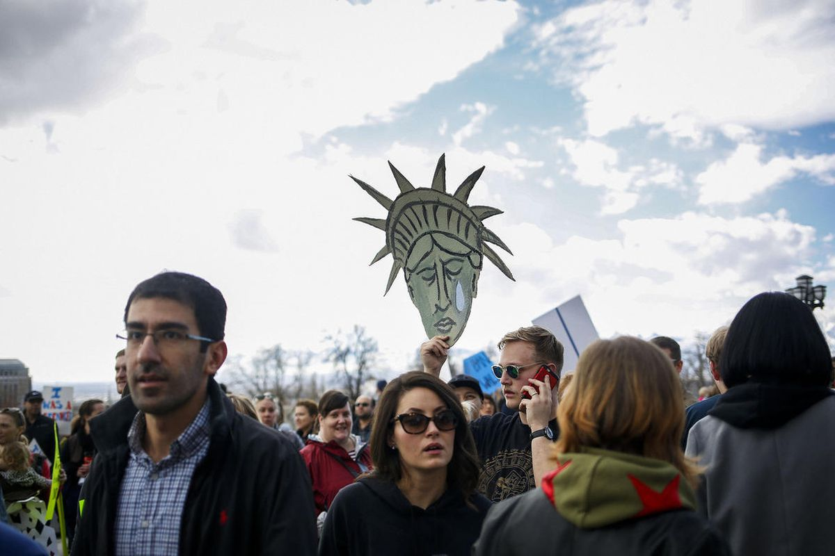 """FILE""""""""The Utah March for Refugees and the Mormons for Muslims march meet outside the Utah State Capitol in Salt Lake City on Saturday, Feb. 4, 2017 to protest President Trumps ban on refugees and immigrants from Muslim countries."""