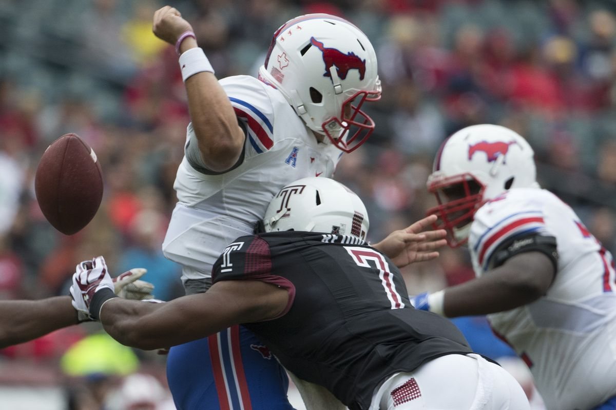 PHILADELPHIA, PA - Temple owls linebacker Haason Reddick (7) forces a fumble out of Southern Methodist Mustangs quarterback Ben Hicks (8) at Lincoln Financial Field.