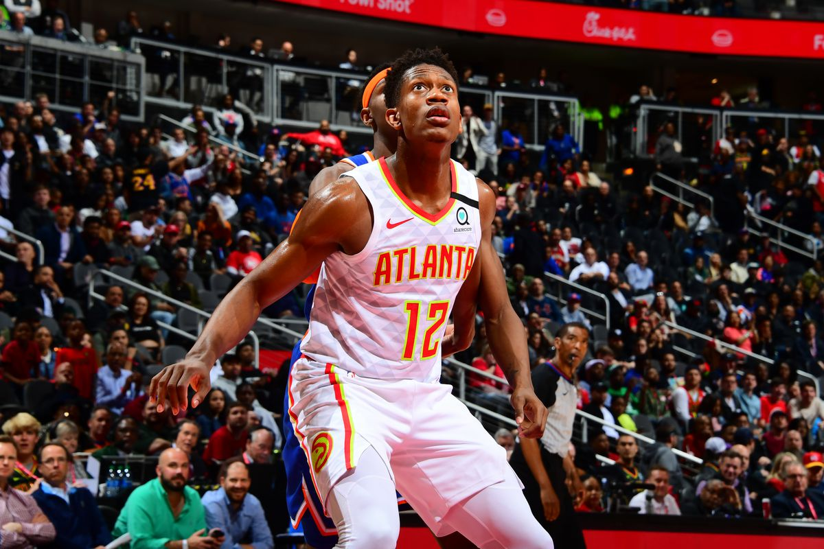 De'Andre Hunter #12 of the Atlanta Hawks looks on during the game against the New York Knicks on March 11, 2020 at State Farm Arena in Atlanta, Georgia.