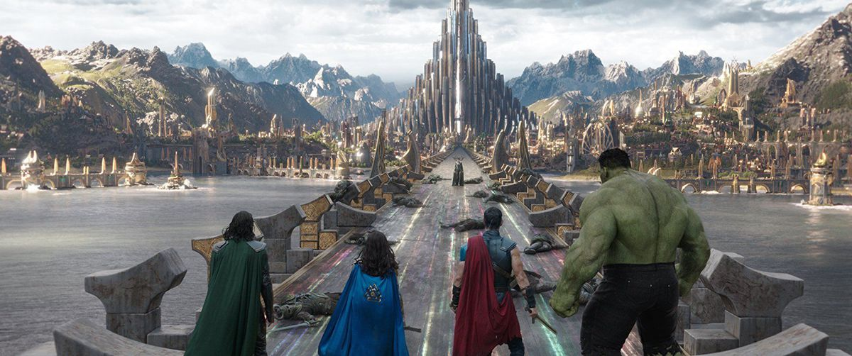 Loki, Valkyrie, Thor, and the Hulk (Hela in background) in Asgard in Thor: Ragnarok.