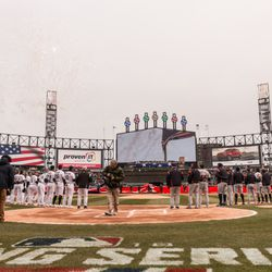 Players from the White Sox and Tigers stand for the National Anthem. | Erin Brown/Sun-Times