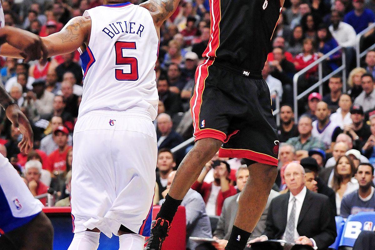 LeBron James shoots over Caron Butler.