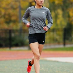 Von Steuben's Tiffany Lam runs in the meet where she took first place at River Park.
