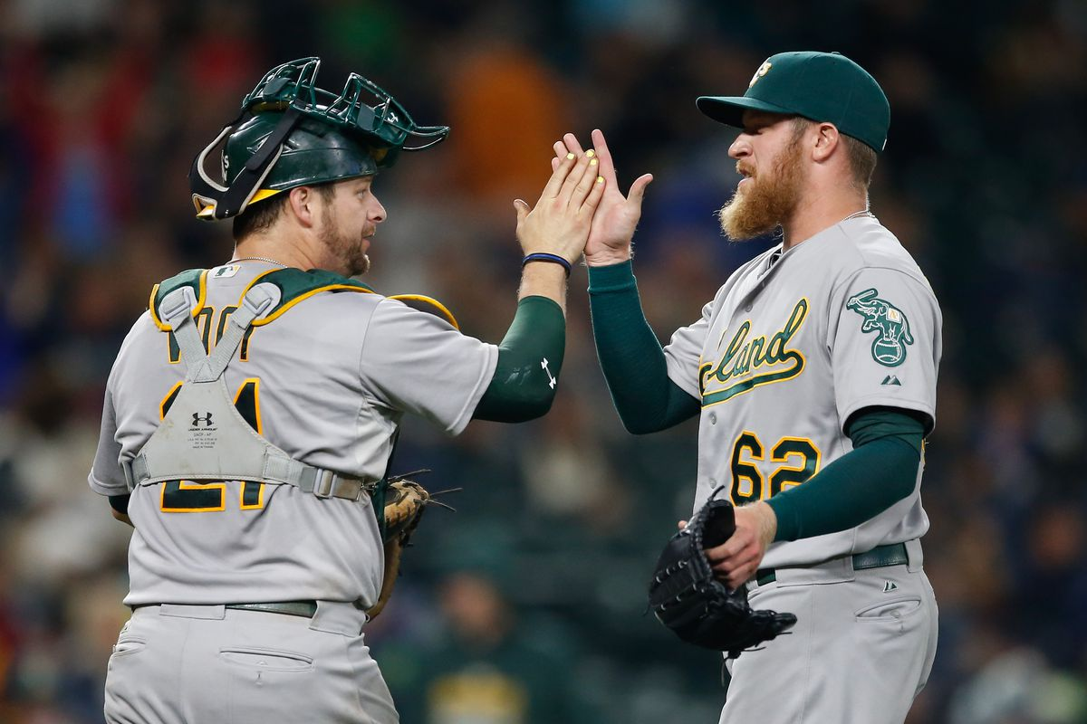 Sean Doolittle and Stephen Vogt celebrate a victory over the Seattle Mariners.