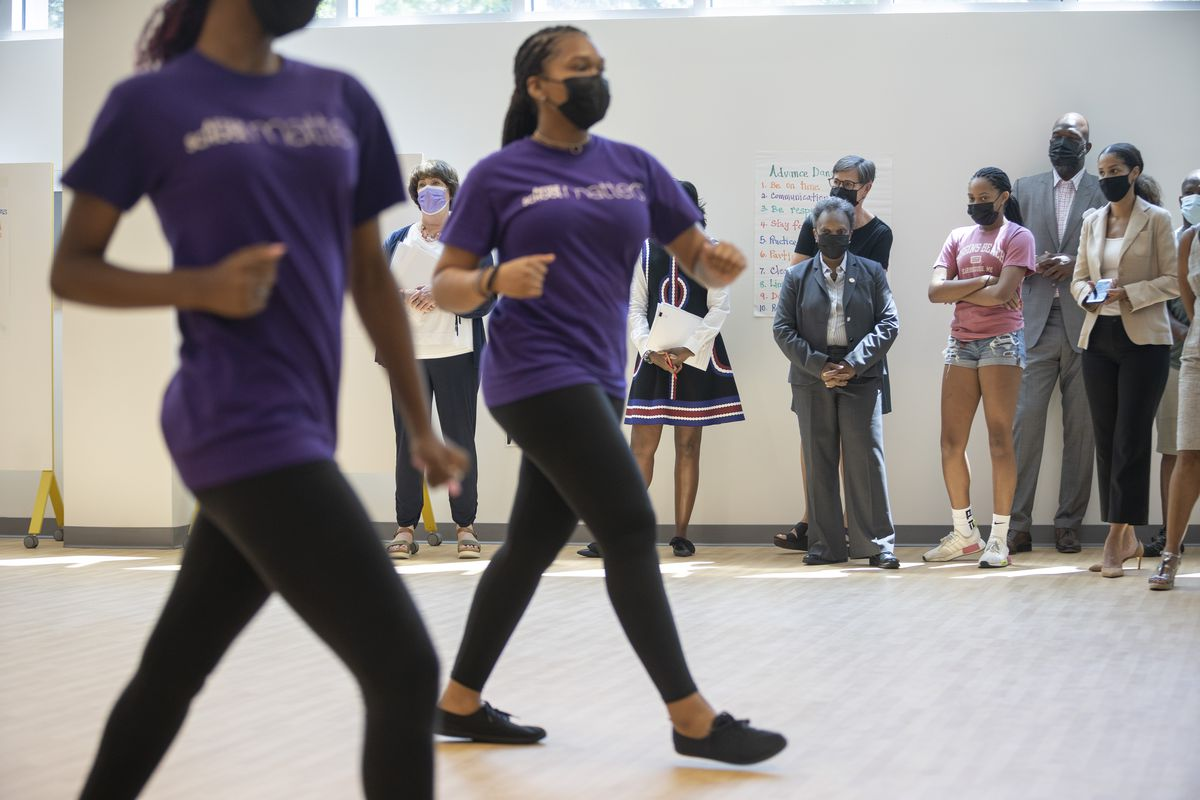 Mayor Lori Lightfoot watches students dance during a tour at a ribbon cutting ceremony for the new combined indoor track and After School Matters flagship site, 10201 S. Cottage Grove Ave., in Gately Park in Pullman on Tuesday, July 6, 2021.