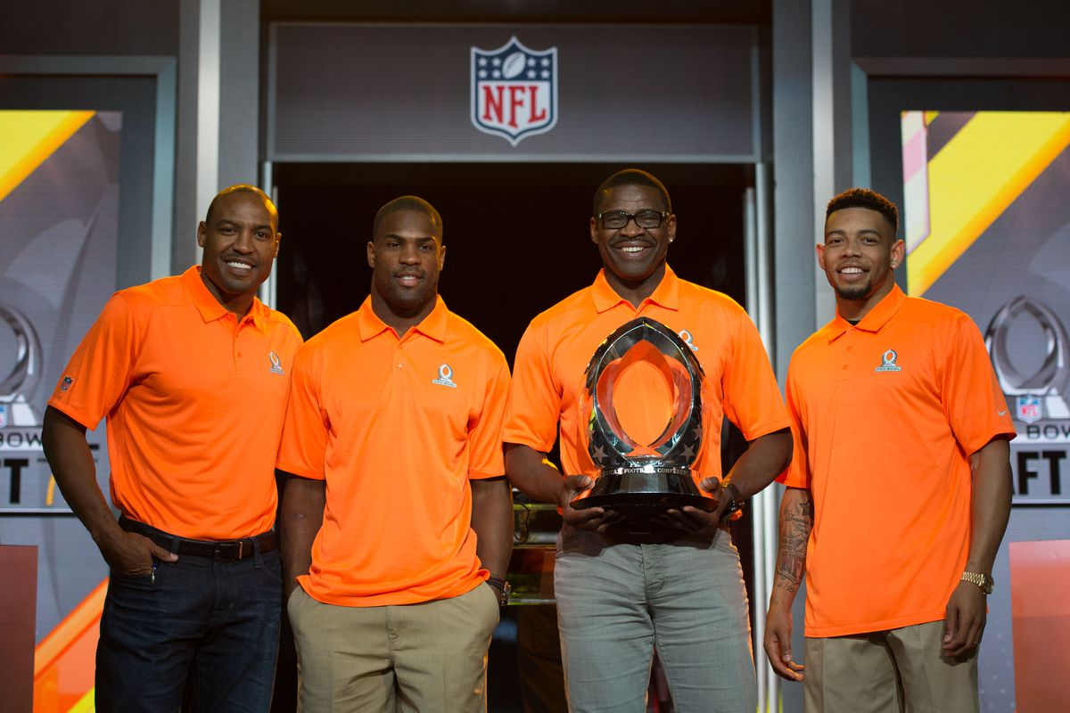 Darren Woodson, DeMarco Murray, Michael Irvin, and Joe Haden, Team Irvin captains. One of these is not like the others.