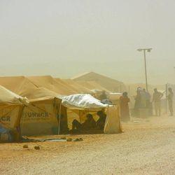 Syrian refugees endured harsh summer conditions in the Zaatari refugee camp in Jordan.