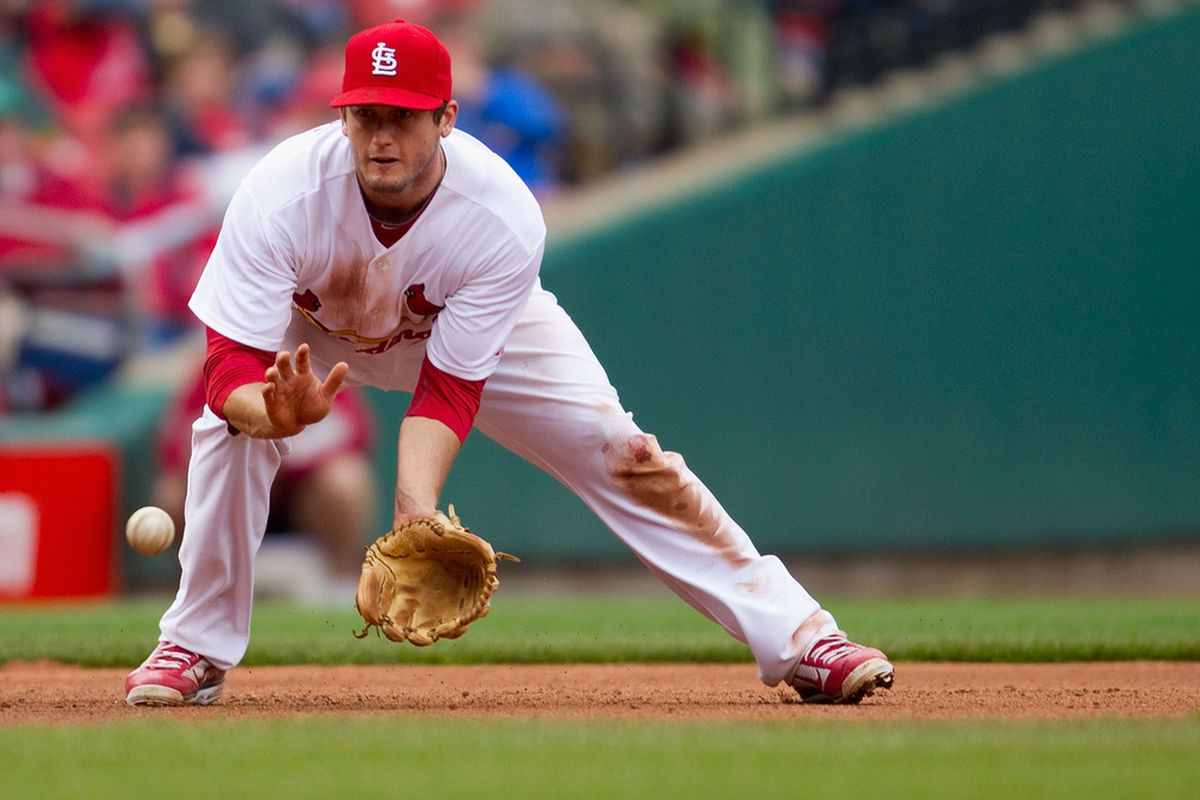 ST. LOUIS, MO - APRIL 23: David Freese #23 of the St. Louis Cardinals fields a ground ball against the Cincinnati Reds at Busch Stadium on April 23, 2011 in St. Louis, Missouri.  (Photo by Dilip Vishwanat/Getty Images)
