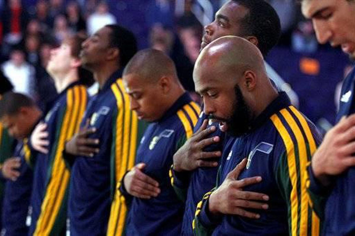 Utah Jazz point guard Jamaal Tinsley (6) and teammates take a moment of silence before an NBA basketball game against the Phoenix Suns Friday, Dec. 14, 2012, on behalf of the school shooting victims in Connecticut earlier today and their families  in Phoe