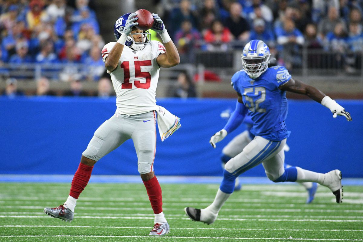 New York Giants wide receiver Golden Tate completes a pass during the second quarter against the Detroit Lions at Ford Field.