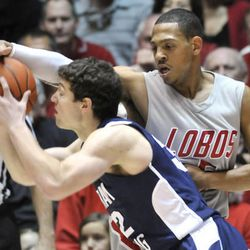 New Mexico's Dairese Gary, right, defends against BYU\'s Jimmer Fredette during an NCAA college basketball game on Saturday, Jan. 29, 2011, in Albuquerque, N.M. New Mexico won 86-77 over 9th ranked BYU.