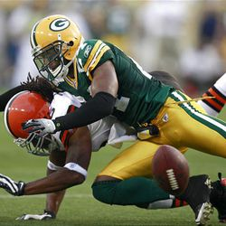 Green Bay Packers cornerback Jarrett Bush, top, breaks up a pass intended for Cleveland Browns wide receiver Josh Cribbs.