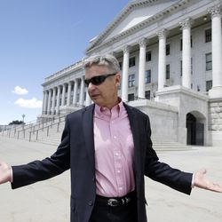 FILE - In this May 18, 2016 file photo, Libertarian presidential candidate, former New Mexico Gov. Gary Johnson leaves the Utah State Capitol after meeting with with legislators, in Salt Lake City.