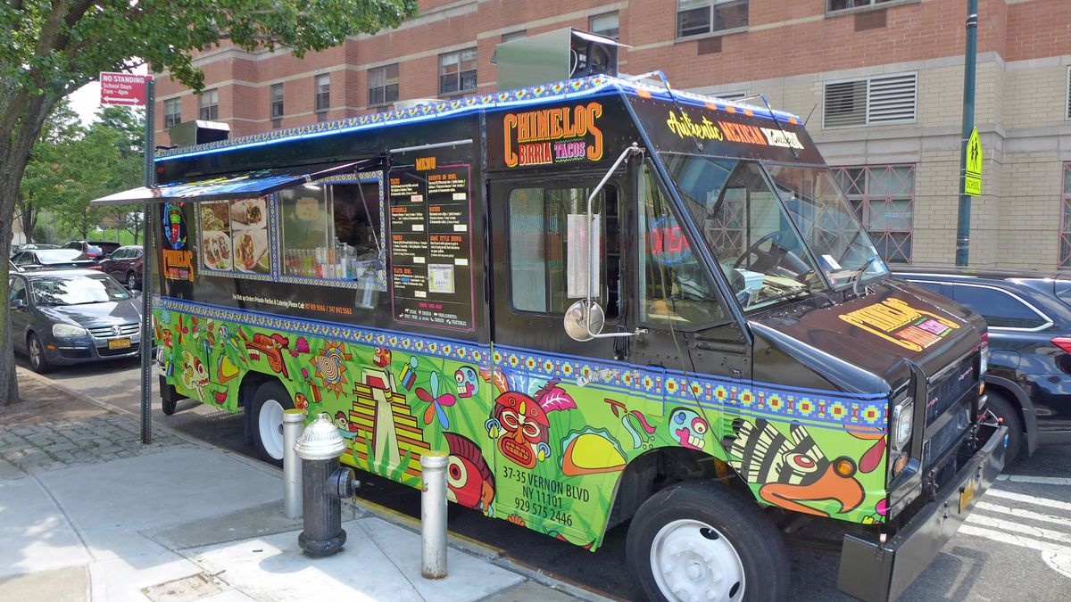 A black van painted with colorful Mexican motifs.