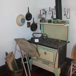 A 20-pound iron, metal washboard and old gas stove in John Rowe Moyle's old house, much like the ones the Mormon pioneers would have used. Moyle's house has been turned into a museum with old pioneer artifacts and replicas.