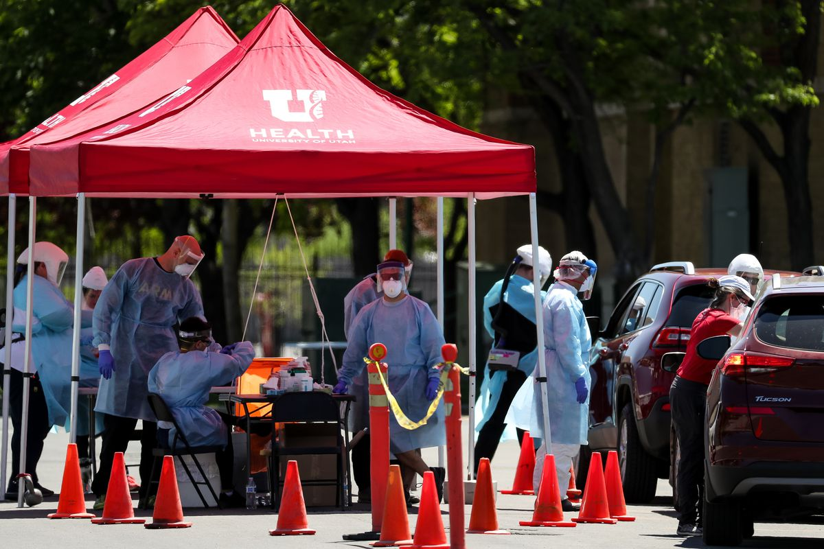 Health care workers test people for COVID-19 at a temporary testing site at the Utah State Fairpark in Salt Lake City on Saturday, May 9, 2020. Saturday's testing event was the first in a series aimed at providing testing to Utah's underserved communities.