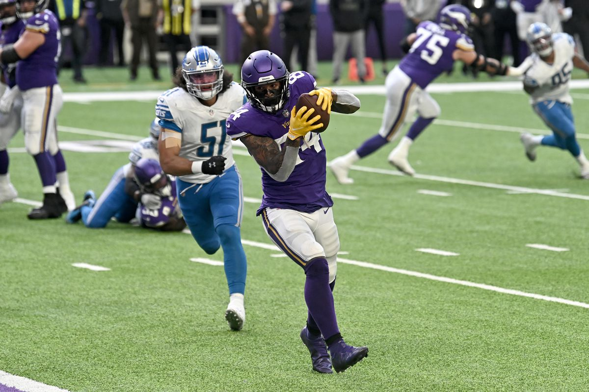Irv Smith Jr. #84 of the Minnesota Vikings catches the ball in front of Jahlani Tavai #51 of the Detroit Lions to score a touchdown in the third quarter at U.S. Bank Stadium on November 08, 2020 in Minneapolis, Minnesota.