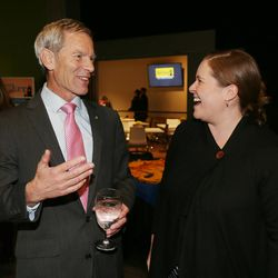 Salt Lake City Mayor Ralph Becker talks with supporter Katherine Potter while at his election night party at Club 50 West in Salt Lake City on Tuesday, Nov. 3, 2015.