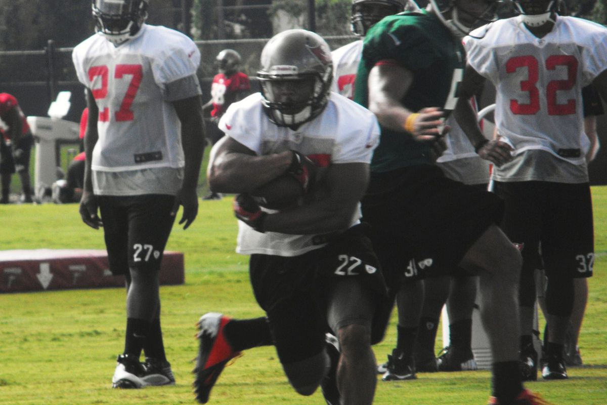 Legarrette Blount looks on as rookie Doug Martin receives a handoff from Josh Freeman. Will this be a recurring theme this season?  Photo credit: Lee Caswell, Bucsnation.com