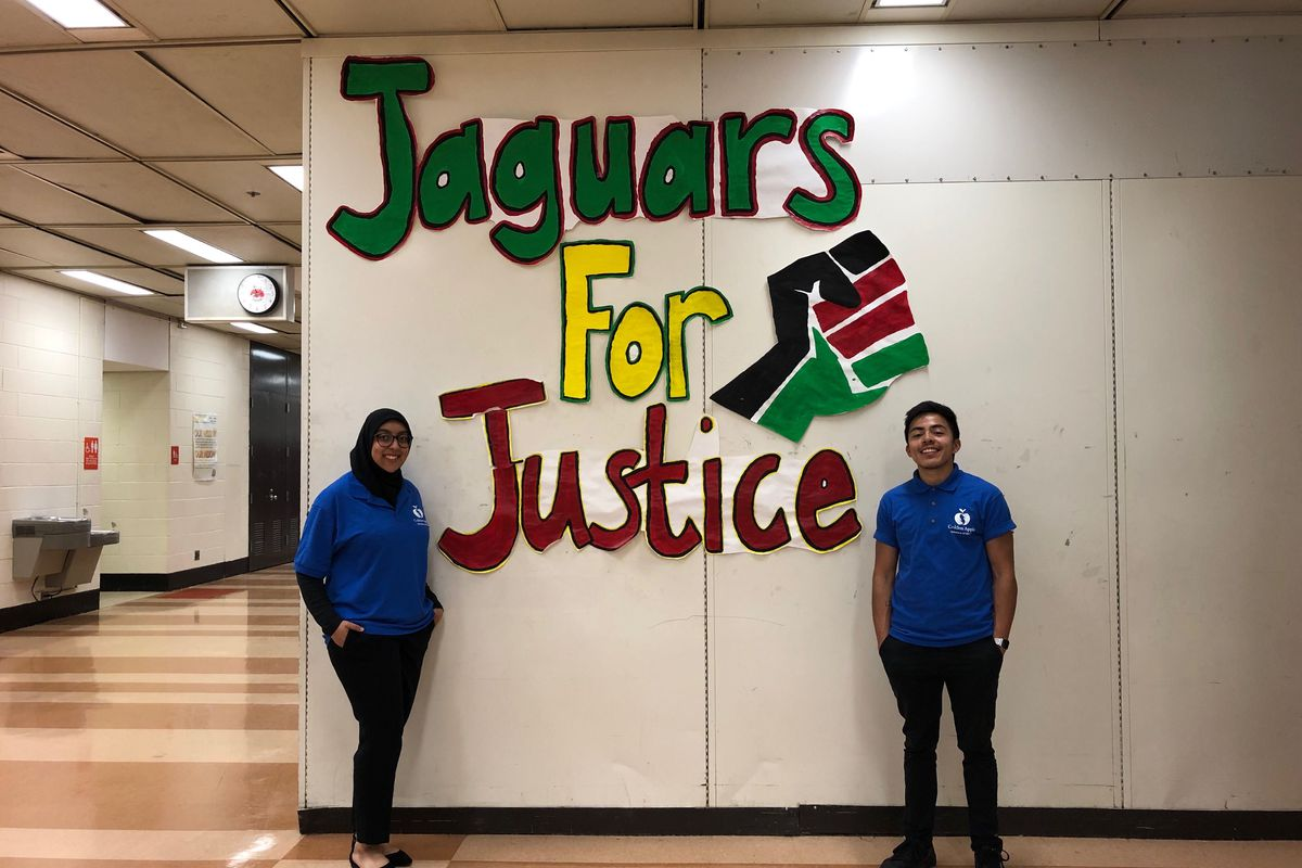 Teacher hopefuls Noor Maghrebi and Leo Sanchez take a break from teaching to pose at Julian High School in Chicago, IL.