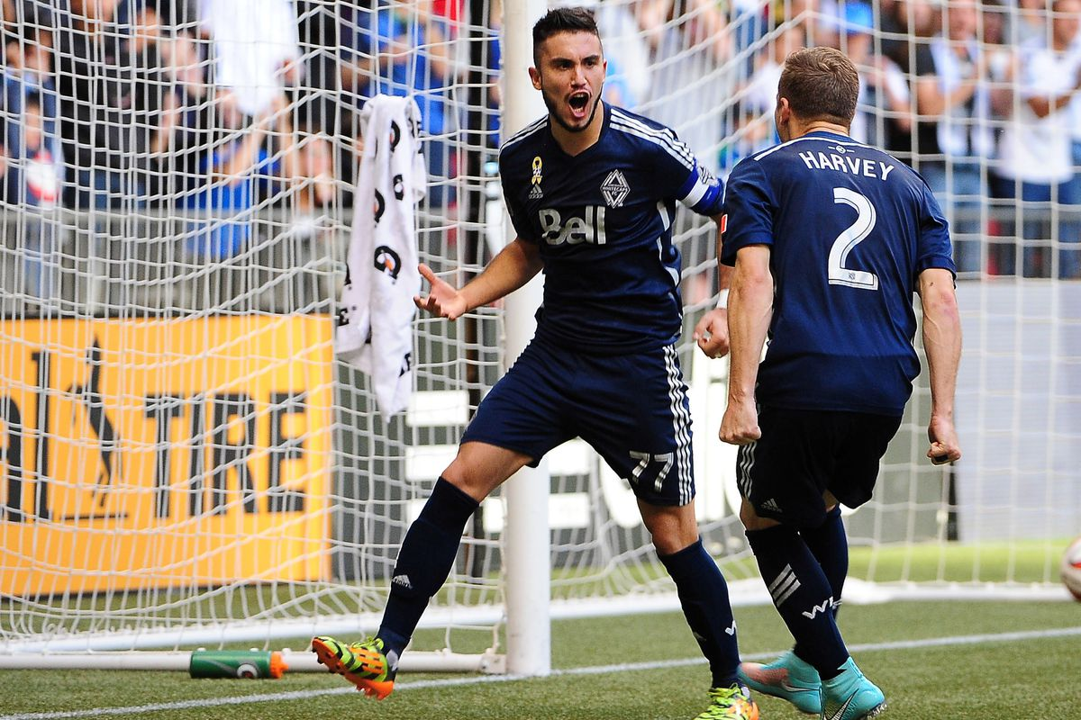 Pedro Morales (L) and Jordan Harvey celebrate Morales' penalty kick that brought the Vancouver Whitecaps back on to level terms with Real Salt Lake.