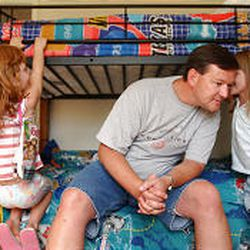Michael Gulbraa joins daughters Natalie, left, and Stephanie in his sons' room. His ex-wife took the boys to Japan three years ago.