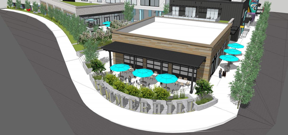 A rendering of patio space at the foot of the hotel, encased in trees and shrubs.