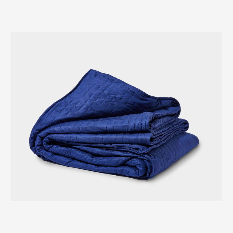 Folded indigo-colored blanket.