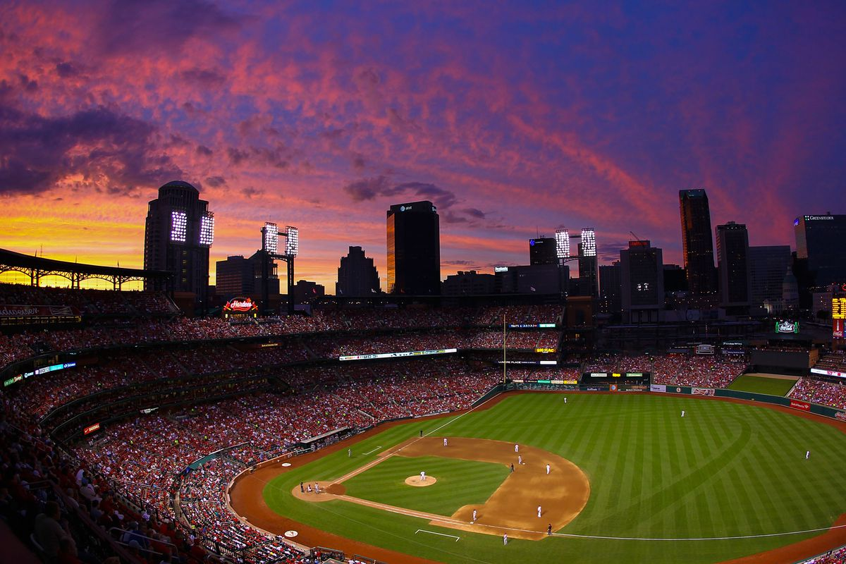 The sunsets over Busch Stadium during a game between the St. Louis Cardinals and the Arizona Diamondbacks on June 6, 2013 in St. Louis, Missouri.