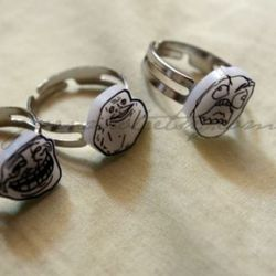 """<a href=""""http://www.etsy.com/listing/66321136/internet-meme-rings-set-of-3-fuuuuuuu"""" rel=""""nofollow"""">Trollface rings</a>: wear them together or forever alone."""