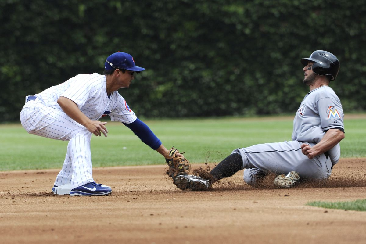 Chicago, IL, USA; Miami Marlins outfielder Justin Ruggiano is tagged out on a steal attempt at second base by Chicago Cubs second baseman Darwin Barney at Wrigley Field. Credit: David Banks-US PRESSWIRE